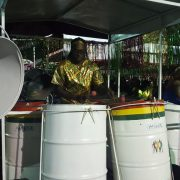 close shot of steel drums and a drummer
